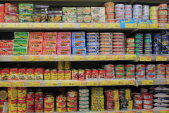 Shelves with can in supermarket Stock Photo