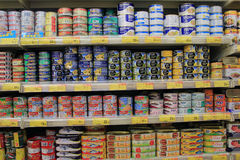 Shelves with can in supermarket Royalty Free Stock Image