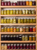 Shelves of canned goods stock photos