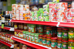 Shelves with canned goods Royalty Free Stock Images