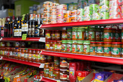 Shelves with canned goods Royalty Free Stock Photos