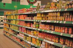 Shelves with canned vegetables Stock Photos