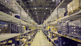 Shelves of cardboard boxes inside warehouse stock video