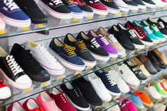 Shelves with casual shoes Stock Photography