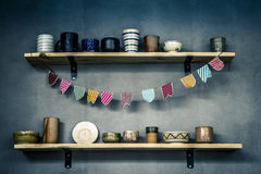 Shelves with ceramic dishes Royalty Free Stock Image