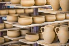 Shelves with ceramic dishware stock image