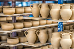 Shelves with ceramic dishware Stock Images
