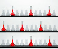 Shelves in the chemistry laboratory with many flas Stock Photo