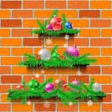 Shelves Christmas tree red brick. Christmas tree of three wood shelves showcases with shadow on red brick wall background. Advertising holiday shelf store. Sale Stock Photo