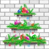 Shelves Christmas tree white brick. Christmas tree of three wood shelves showcases with shadow on white brick wall background. Advertising holiday shelf store Royalty Free Stock Images