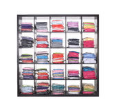 Shelves with clothes Stock Images