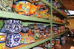 Shelves of colorful pottery, FL Royalty Free Stock Images