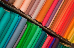 Shelves of colorful textiles and fabrics Stock Photo