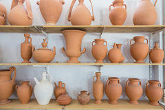Shelves with different brown clay  jars and pots Stock Photography