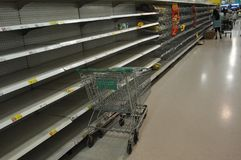 The shelves are empty in a Bangkok supermarket in October 2011 as people prepare for the incoming flood.  Stock Image
