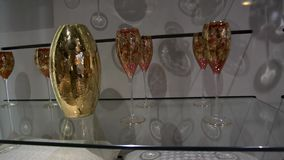Shelves With Vintage Glasses. Shelves with expensive beautiful vintage wine and champagne glasses. Retail industry stock video footage