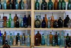 Shelves filled with antique bottles for sale, Washington Fairgrounds, Greenwich, New York, 2016 Stock Image