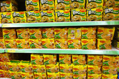 Shelves filled with instant noodle from Maggi in retail market Stock Photos