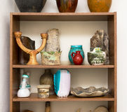 Shelves full of unique artistic creative pottery objects in pot Stock Photos