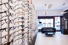 Shelves with glasses. Optician's shop shelves with eyeglasses rims Royalty Free Stock Photo