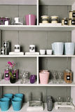 Shelves with goods. Close-up store shelves with a different product. Flower pots, flowers, vsechi, podstvaki, decorative objects and interior Stock Photos