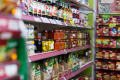 Shelves at groceries section of average Polish supermarket Royalty Free Stock Photography