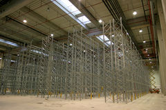 Shelves in hall factory. New large hall in factory with shelves Stock Images