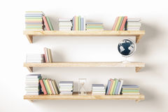 Shelves with items on light wall Royalty Free Stock Image