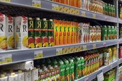 Shelves with the juices in the supermarket Stock Photography