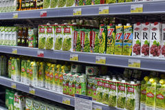 Shelves with the juices in the supermarket Stock Images