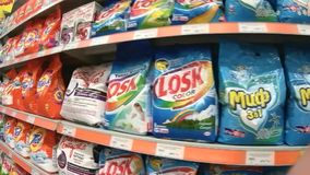 Shelves with laundry detergents in the supermarket stock footage