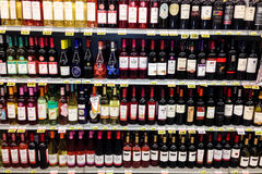 Shelves with many bottles of alcohol in grocery store Stock Photo