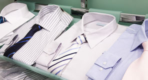 Shelves with men shirts Stock Image