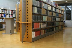 Shelves in a modern library Stock Photos