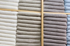 Shelves with multicolor bath towels Stock Image