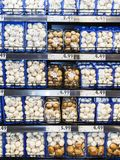 Shelves with mushroom, for sale in a supermarket Stock Image