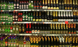 Free Shelves Of Supermarket With Champagne And Martini. Royalty Free Stock Photos - 89971838