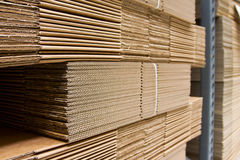 Shelves with packaging carboard close-up Royalty Free Stock Photography