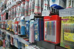 Shelves of pens in supermarket. Whole shelves of colourful markers and pens royalty free stock image