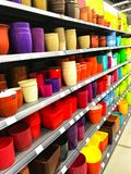 Shelves with pots for flowers of different colors in the shopping center ALL, Minsk, Belarus Stock Photos