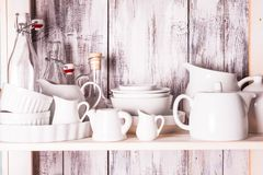 Shelves in the rack. In the kitchen at shabby chic style royalty free stock photos