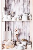 Shelves in the rack. In the kitchen at shabby chic style Stock Images
