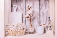 Shelves in the rack. In the kitchen at shabby chic style Stock Image