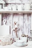 Shelves in the rack. In the kitchen at shabby chic style Stock Photo