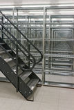 Shelves of a rack lineup. A lineup of racks for storage in a warehouse Royalty Free Stock Image