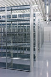 Shelves of a rack lineup. A lineup of racks for storage in a warehouse Stock Photo