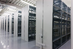 Shelves of a rack lineup. A lineup of racks for storage in a warehouse Stock Photos