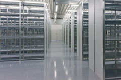 Shelves of a rack lineup. A lineup of racks for storage in a warehouse Stock Images