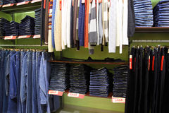 Shelves and racks with clothes in shop Royalty Free Stock Photography