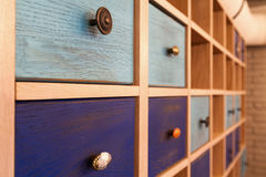 Shelves. Room decoration colored shelves and drawers Royalty Free Stock Photo